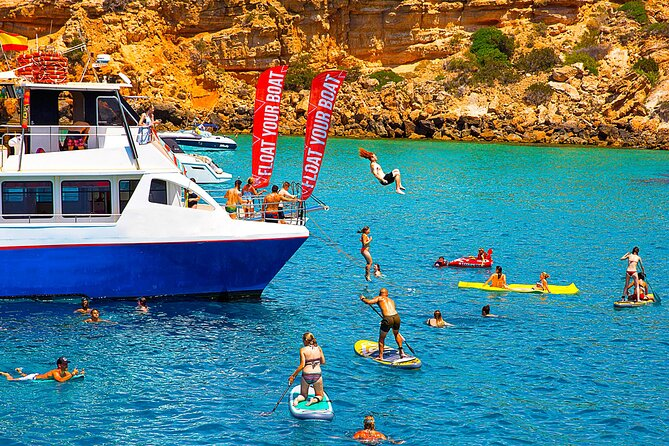 Cala Conta and Cala Bassa Beach Cruise with Paddle Surf, Snorkel and Drinks