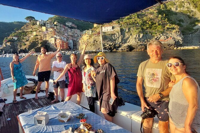Sunset Cinque Terre Boat Tour with a traditional ligurian gozzo from Monterosso