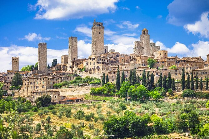 Private Transfer from Florence to Rome with stops in S Gimignano & Montepulciano