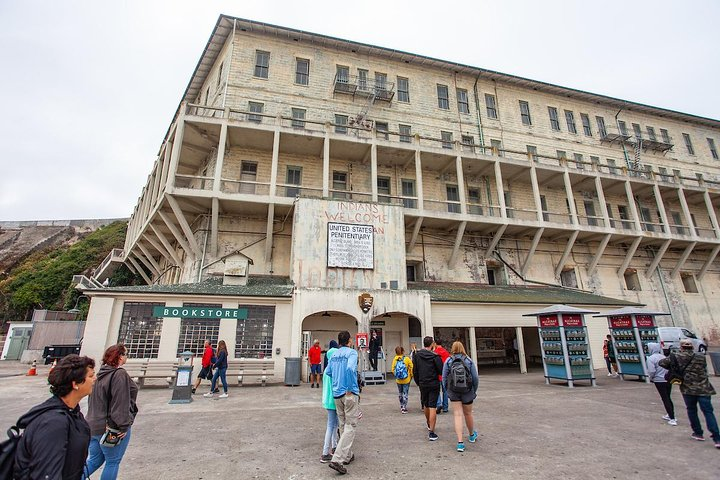 Travelers explore Alcatraz and listen to the self-guided audio tour, photo