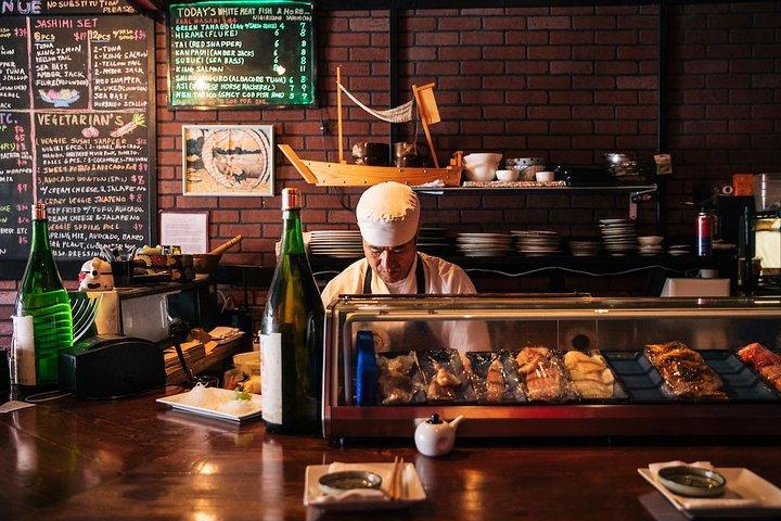 A chef prepares a Japanese horse mackerel sashimi at Coco's Ramen.