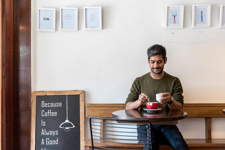 Ryan enjoys at coffee at White Mulberries Cafe, one of his favorite haunts near St. Katherine Docks. Photo Credit: Annapurna Mellor