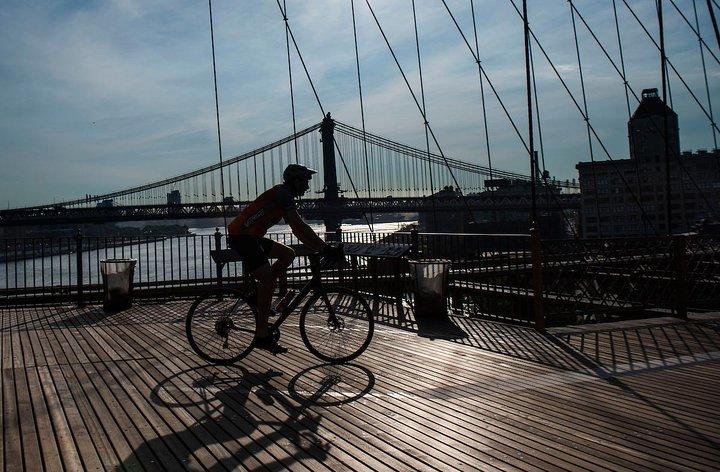 A cyclist crosses the Brooklyn Bridge. Photo Credit: Amanda Voisard