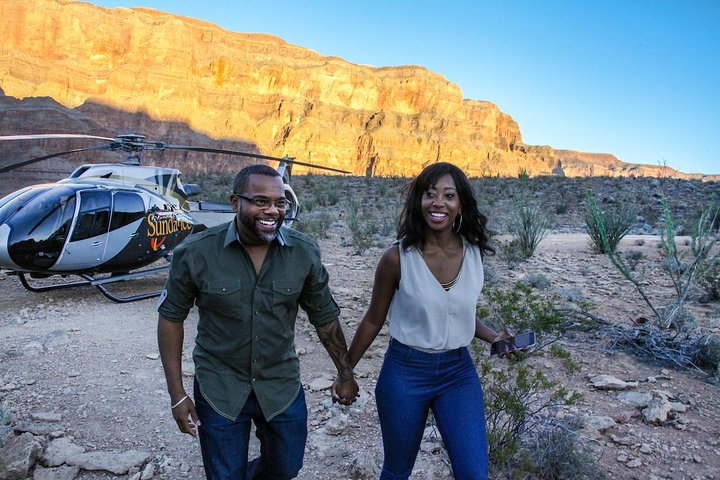 Couple disembarks helicopter for dining experience at the Grand Canyon's West Rim.