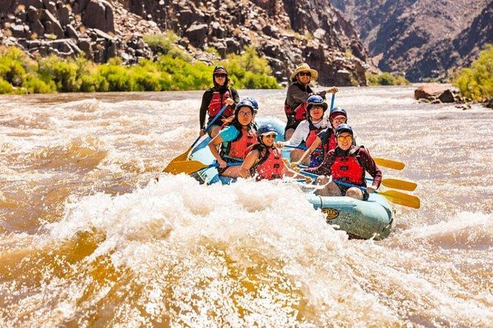 Group on a white-water raft tackling the rapids on the Colorado River