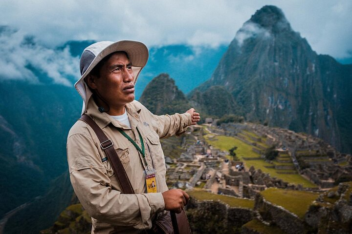 Tour guide with Machu Picchu in the background
