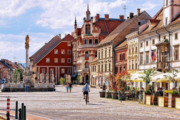 A person rides their bike through the center of Maribor, Slovenia.
