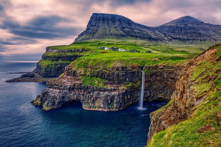 A waterfall tumbles over the side of a cliff near Gásadalur village in the Faroe Islands.
