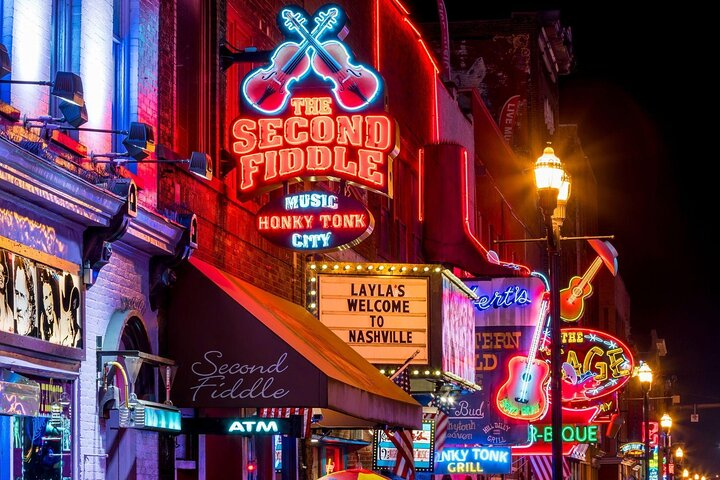 Neon lights and signs dominate the buildings in downtown Nashville, Tennessee.