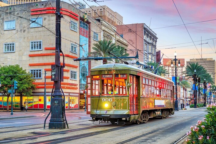 A vintage tram rolls through New Orleans' French Quarter.