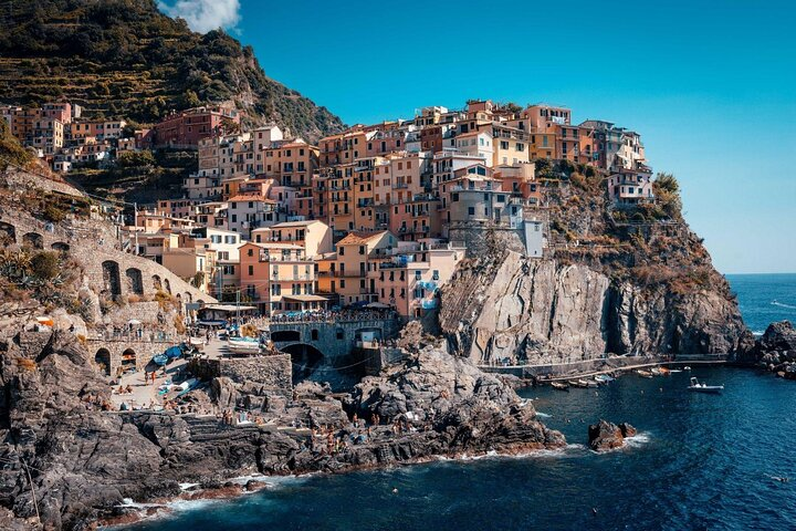 The colorful houses of Cinque Terre perch on the cliffside in Liguria, Italy.