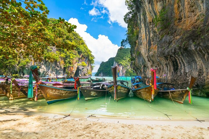 Boats rest on the sands of Ko Phi Phi Lee in Thailand.