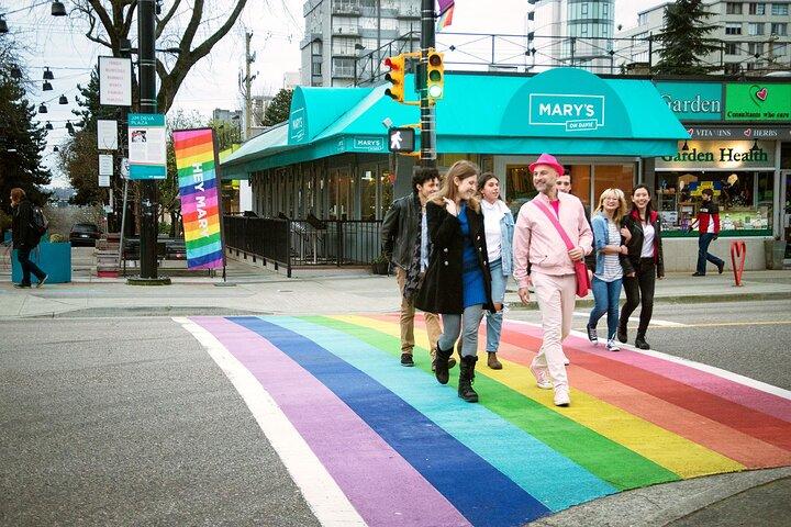 Tour group walks on Vancouver's rainbow crosswalk.