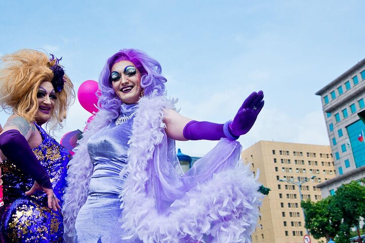 Two drag queens stand on the street during Taipei, Taiwan's Pride Parade.