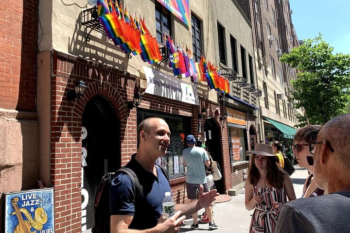 Tour group outside the historic Stonewall Inn in NYC.