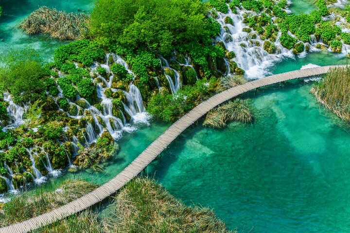 A walkway crosses one of the lakes in Plitvice Lakes National Park, Croatia.