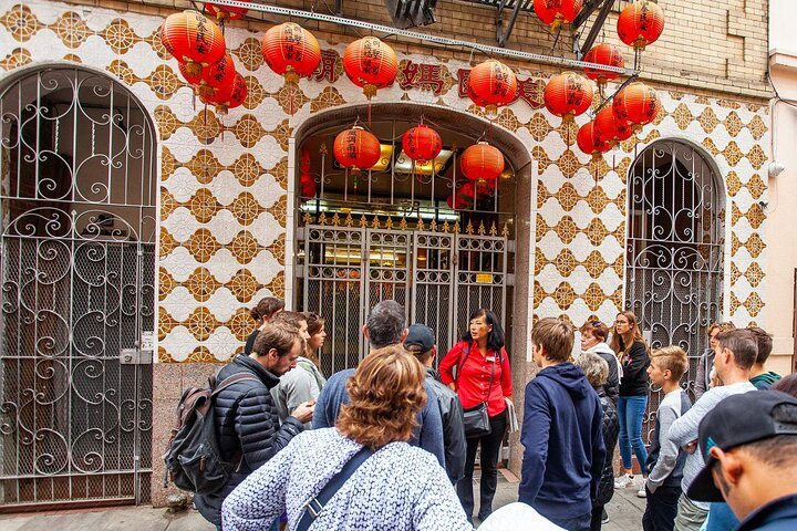 A guide leads a group around Chinatown, San Fransico