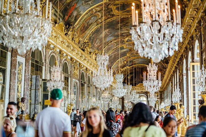 Visitors explore the halls of the Palace of Versailles.