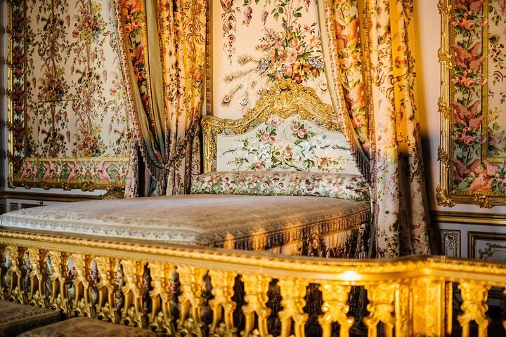 A golden bedroom in the Palace of Versailles, France.
