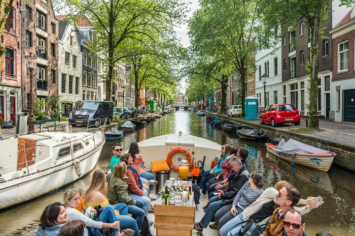 Tourists onboard a boat on the Amsterdam canals