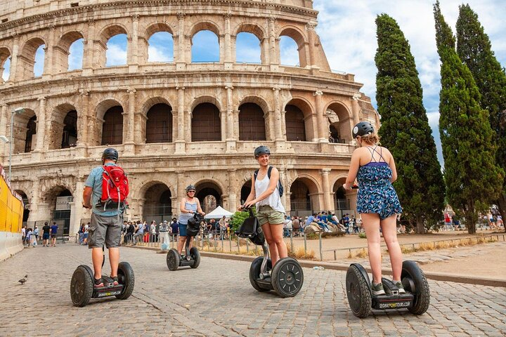Tourists enjoy the sights from the back of a Segway in Rome, Italy