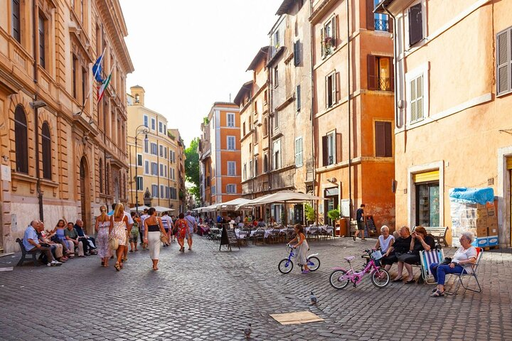 People crowd around the streets of Rome's Jewish Ghetto district