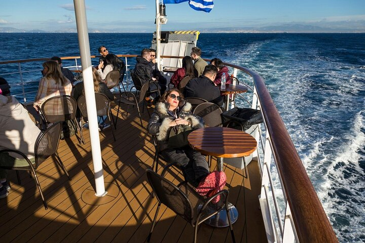 Travelers relax on a boat in the Aegean