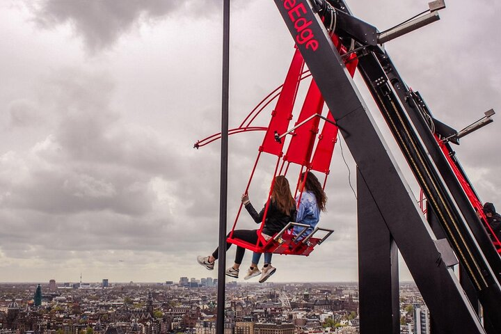 People swing off the A'DAM Lookout in Amsterdam, the Netherlands