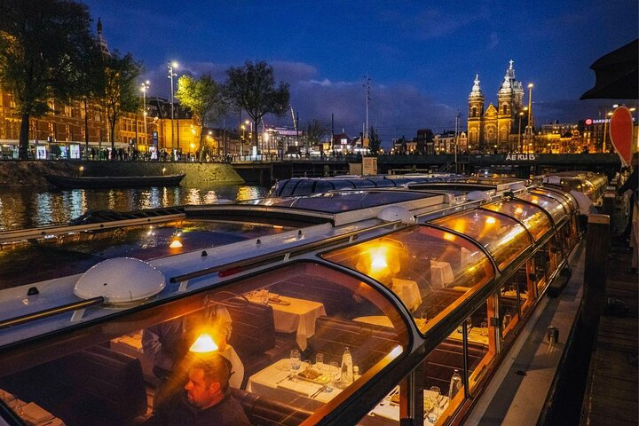 A canal boat waits to set sail in Amsterdam