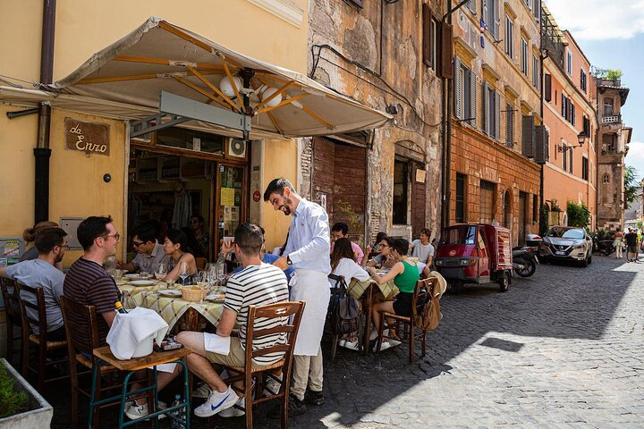 An outdoor family meal on a Rome side street