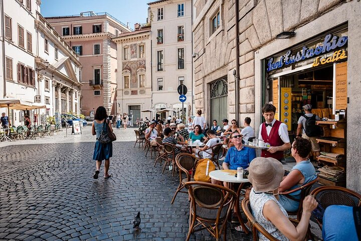 People sitting down for coffee at Sant'Eustachio in Rome, Italy
